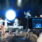 Man filming concert on iPhone, The Hamster Factor