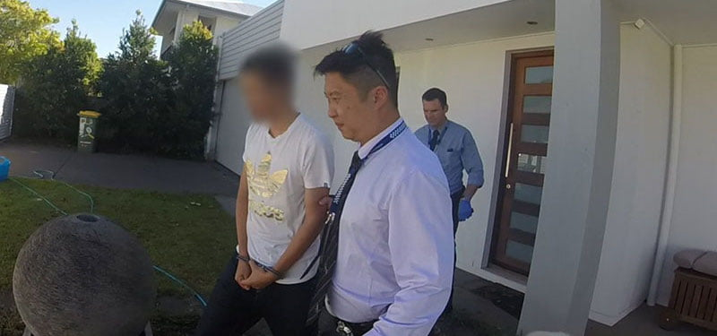The man is arrested by Queensland police's financial and cyber crime group