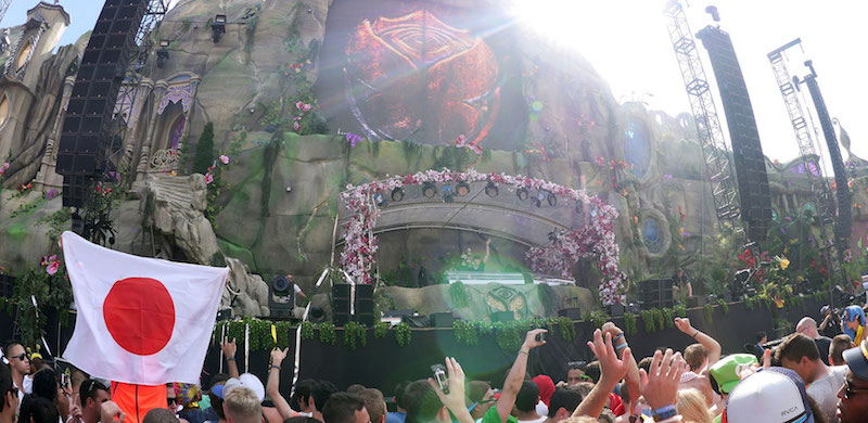 A Japanese fan flies the flag at Tomorrowland 2013