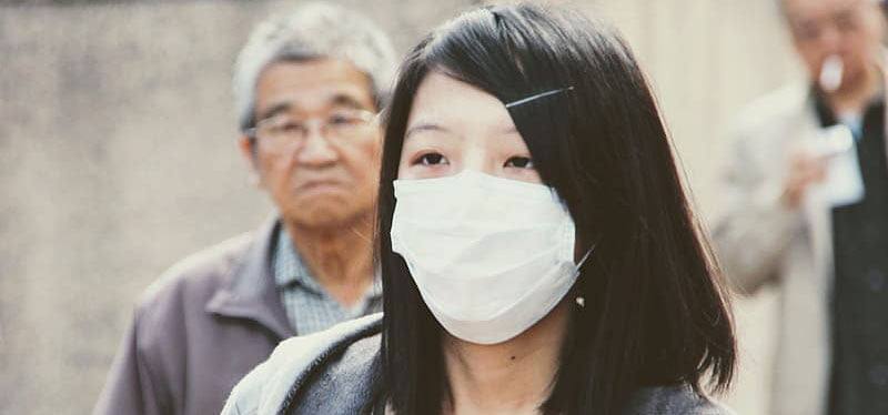 A woman wears a face mask to protect against Covid-19