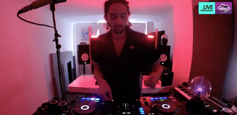 DJ Juan Por Dios spins reggaeton tunes in La Morada's 'garage'