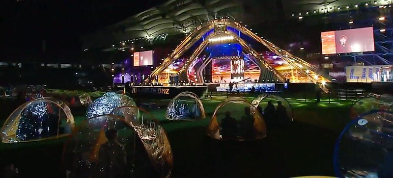 Fans sat in clear tents for Live in DMZ
